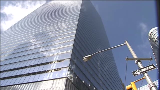 beauty shots of nearly completed one world trade center and spire location: new york city, new york 10;45;00 ms: low angle shot of one world trade... - spire stock videos & royalty-free footage