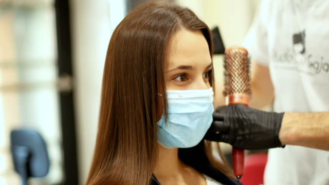 beauty treatment despite the coronavirus - cutting hair stock videos & royalty-free footage