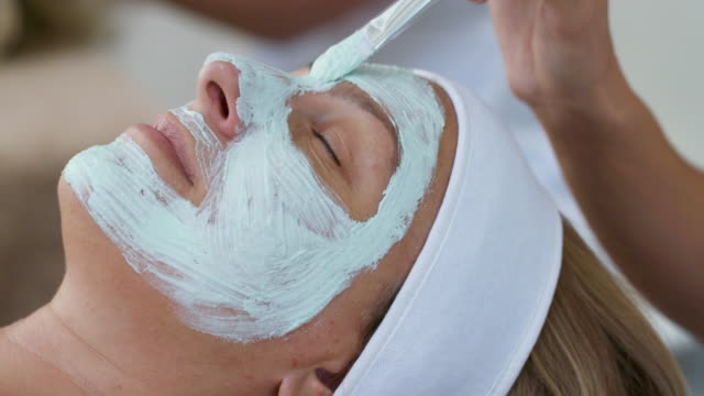 beauty treatments facial masks - scrubbing stock videos & royalty-free footage