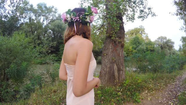 beauty with wreath walking in nature - wreath stock videos & royalty-free footage