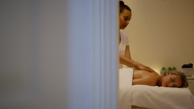 because a spa day is like a small vacation - massaging stock videos & royalty-free footage