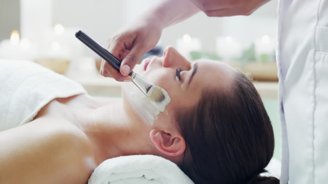 because facials are more relaxing than flowers - massage stock videos & royalty-free footage