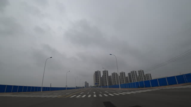 because of continuous regulation real estate investment in china is slowing down - grounds stock videos & royalty-free footage