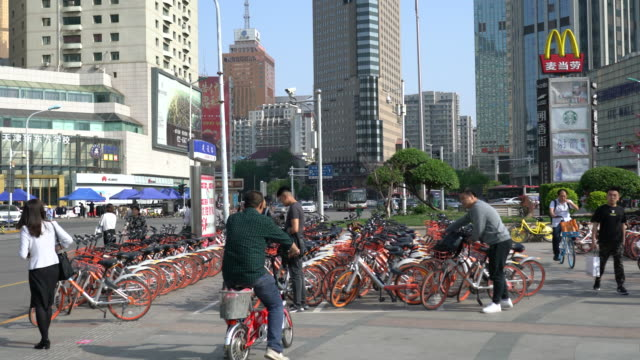because of the previous overheated investment sharing bike industry in china now is faced with problems of overcapacity and difficulty of making... - bicycle parking station stock videos and b-roll footage