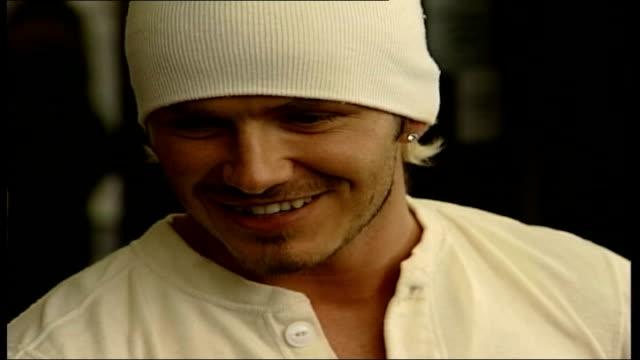 stockvideo's en b-roll-footage met beckham baby lib david beckham speaking to press - 2002