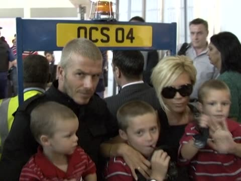 beckham family on board an airport buggy as they leave for where footballer david has signed with galaxy. the three boys sit with their parents and... - galaxy stock videos & royalty-free footage