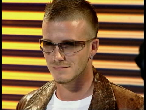 beckham signs autobiography deal lib beckham doing photocall for police sunglasses ext beckham along with wife victoria david and victoria beckham... - 2002 bildbanksvideor och videomaterial från bakom kulisserna