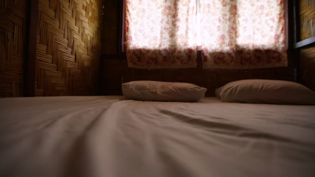 bed in bamboo room sliding shot - satin stock videos & royalty-free footage