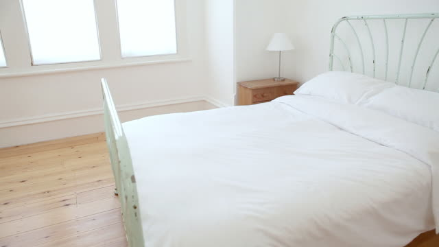 bed in minimally decorated room - simplicity stock videos & royalty-free footage