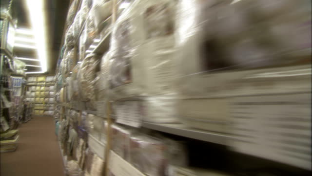 bed linens fill the shelves in a store. - bedclothes stock videos & royalty-free footage