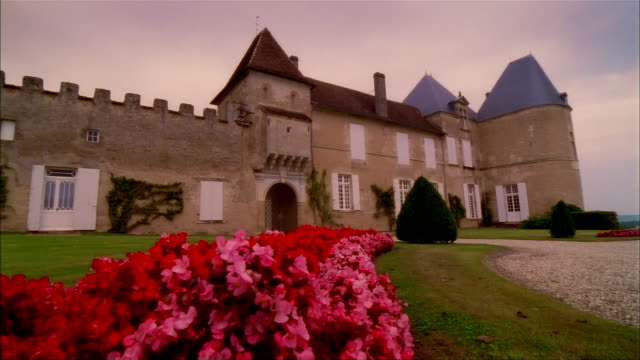 Bed of red and pink flowers outside front entrance to Chateau d'Yquem / Graves, Bordeaux, France