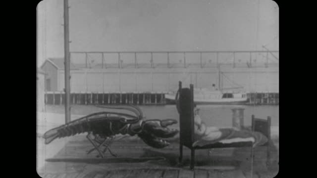 1928 bed riding man fights off giant animated lobster with pants catapult - pillow stock videos and b-roll footage