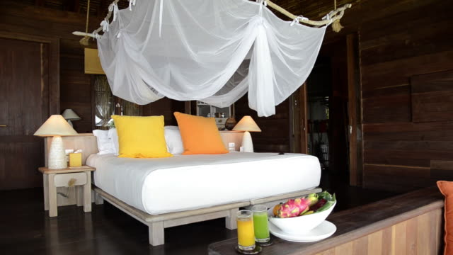 ms bed with moscito net in tropical bedroom of  six senses resort  audio / ka yao noi, phang nga, thailand - netting stock videos and b-roll footage