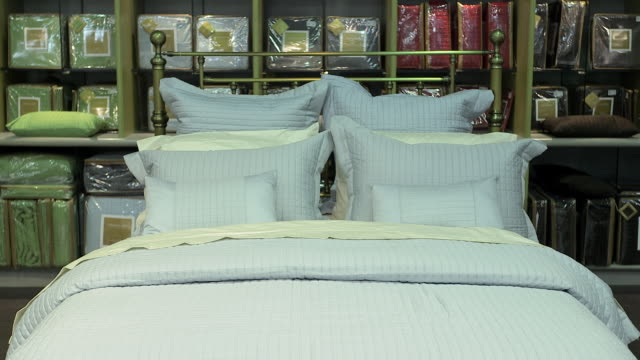 Bedding and pillows displayed in furniture store