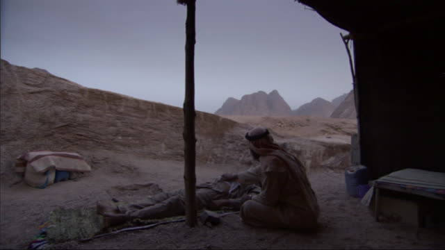 a bedouin practitioner performs traditional medicine in front of his tent. - homeopathic medicine stock videos & royalty-free footage