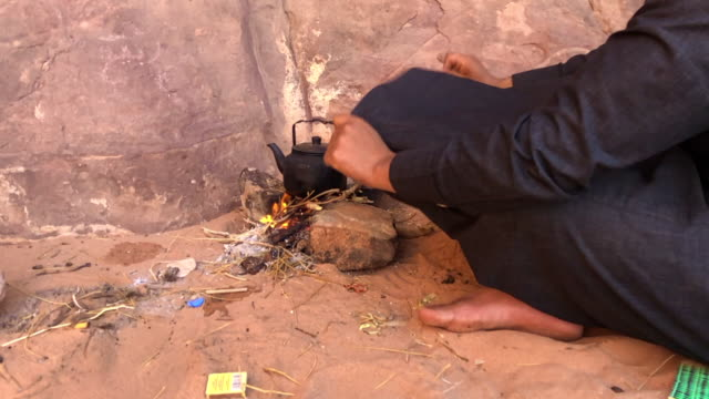 bedouin preparing the tea in the wadi rum desert. - jordan middle east stock videos and b-roll footage