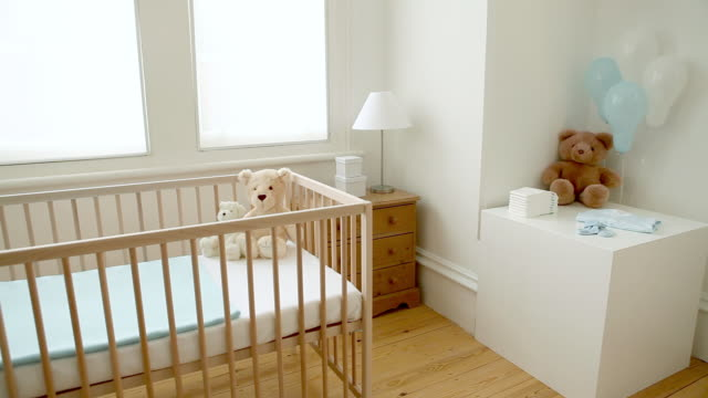 bedroom for a baby boy - cot stock videos & royalty-free footage