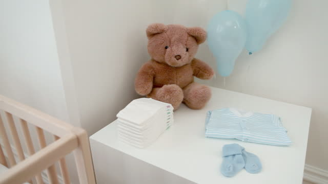 bedroom for a baby boy, with teddy bears and crib - cot stock videos & royalty-free footage