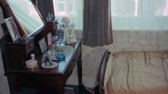 1972 pan bedroom in group home for mental health patient, with patients discussing pleasant atmosphere of group housing / united kingdom - mental health stock videos & royalty-free footage