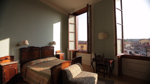WS DS Bedroom Overlooking Old Town Rooftops / Florence, Italy