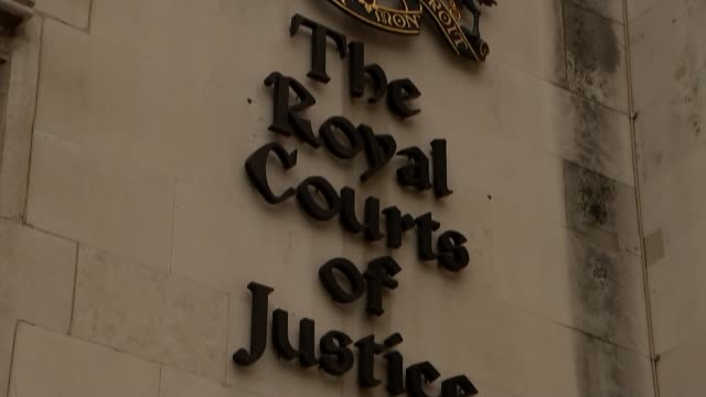 appeal court judges rule that it is discriminatory england london the strand ext various of crest and sign on the wall of the royal courts of justice... - court room stock-videos und b-roll-filmmaterial