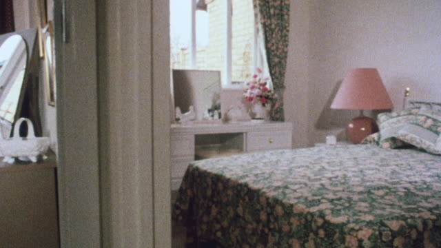 1983 montage bedrooms and living area in a house / woking, england, united kingdom - speisezimmer stock-videos und b-roll-filmmaterial