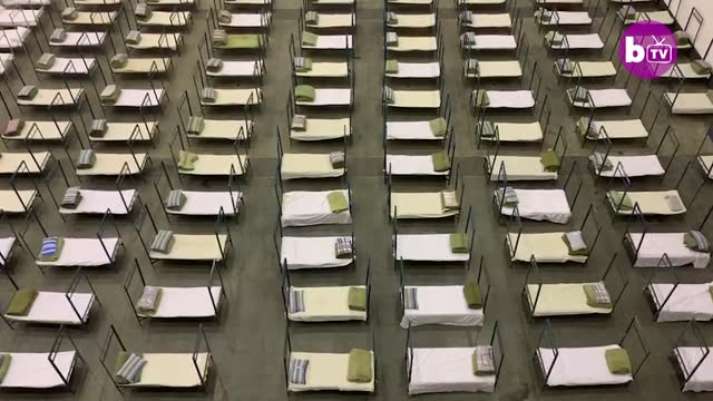 beds being prepared at an exhibition hall into a temporary mobile hospital in wuhanon february 3 in wuhan, china. this facility is one of five mobile... - temporary stock videos & royalty-free footage