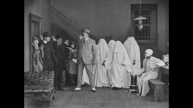 1921 bedsheet ghost criminals hold bank staff hostage in mansion basement after trapdoor falls open - 1921 stock videos & royalty-free footage