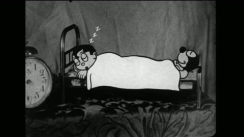 bedsheet slides back and forth across dinky doodle and his dog as they sleep - sleeping stock videos & royalty-free footage