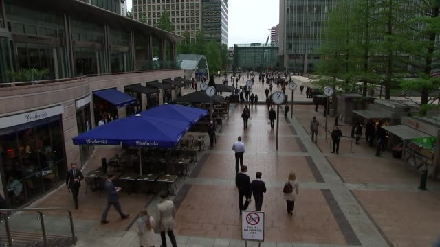 bedtime immersive street performance in canary wharf: views; ext various of people along through pedestrianised square int various of people laying... - bedtime stock videos & royalty-free footage