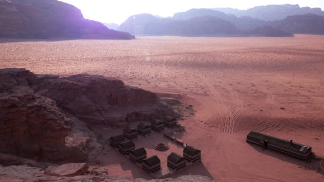 tl beduin camp and mountainous background in wadi rum, jordan - non us film location stock videos & royalty-free footage