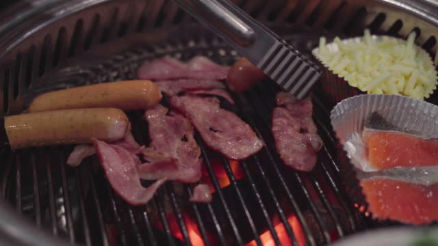 beef and pork on a plate with grilled bbq sauce. grill yakiniku buffet restaurant. - bbq sauce stock videos and b-roll footage