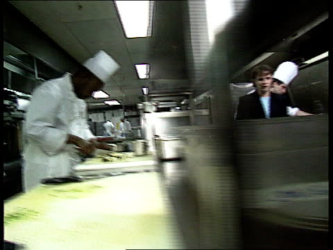 london: dorchester hotel: kitchen cms something cooking in pan track i/c - dorchester hotel stock videos & royalty-free footage