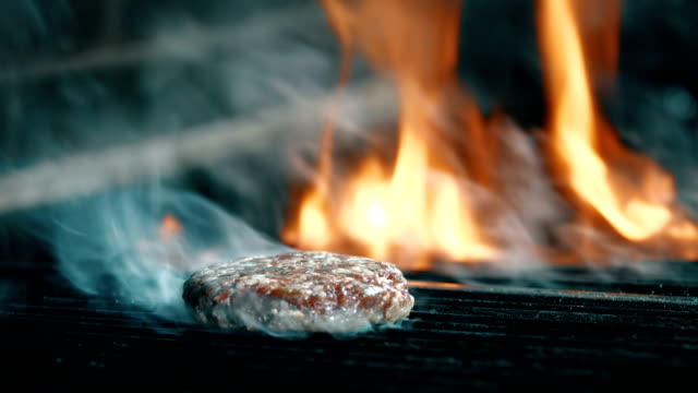 Beef Burger Cooking on Grill