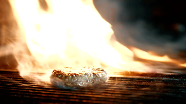 beef burger cooking on grill - burger stock videos and b-roll footage