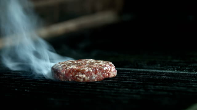 beef burger cooking on grill - grigliare video stock e b–roll