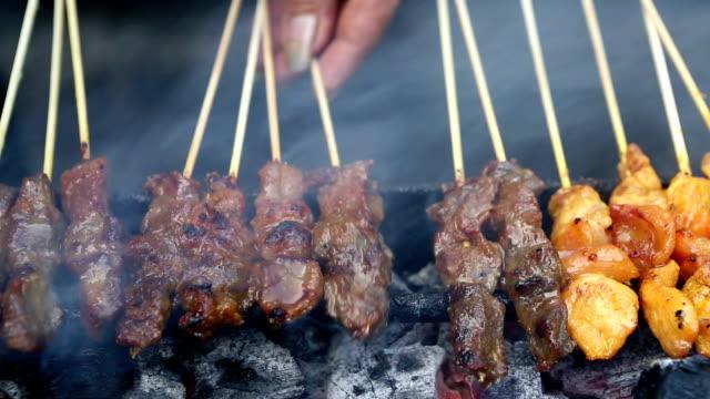 beef chicken satay skewers - kuala lumpur stock videos & royalty-free footage