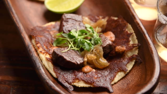 vídeos de stock e filmes b-roll de beef filet mignon taco and a shot of tequila - modo de preparação de comida