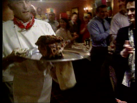 Beef on the bone LIB INT Piper leading procession as platter with rib of beef on is carried into dining room of hotel owned by Sutherland Health...