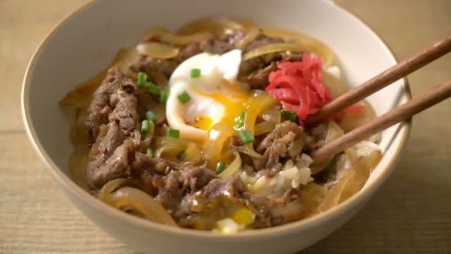 beef sliced on topped rice (gyuu-don) - recipe stock videos & royalty-free footage