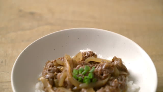 beef sliced on topped rice (gyuu-don) - beef stock videos & royalty-free footage