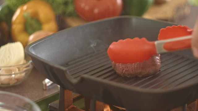 beef steak grilling on frying pan - frying pan stock videos & royalty-free footage
