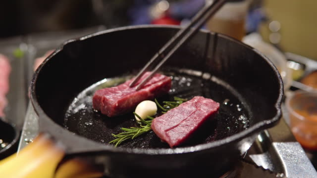 beef steak in a cast iron skillet. - frying pan stock videos & royalty-free footage