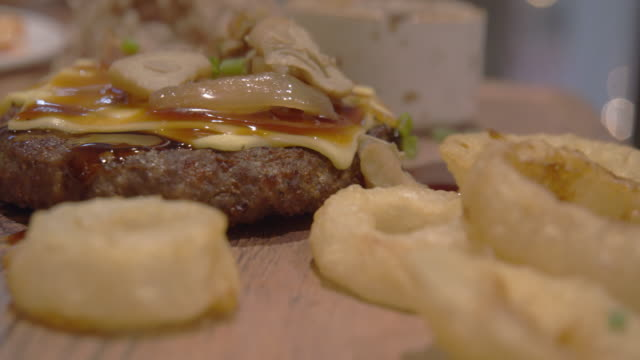 beef steak with slice cheese on top - donburi stock videos and b-roll footage