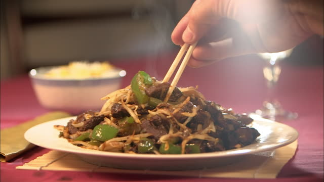 cu beef stir fry picked up with chopsticks - pepper vegetable stock videos & royalty-free footage