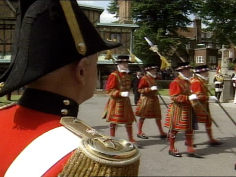 beefeaters march for tourists at the tower of london - tassel stock videos & royalty-free footage