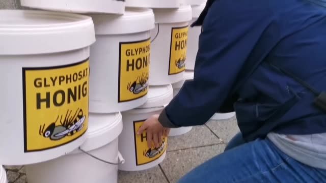 beekeepers demonstrate in front of the german federal agriculture ministry by leaving what amounts to tons of honey deemed unsellable due to their... - herbicide stock videos & royalty-free footage