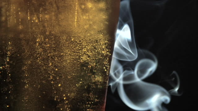 beer and smoke (1080 hd) - tobacco product stock videos & royalty-free footage