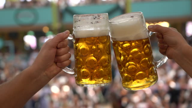beer at oktoberfest, munich, germany - beer glass stock videos & royalty-free footage