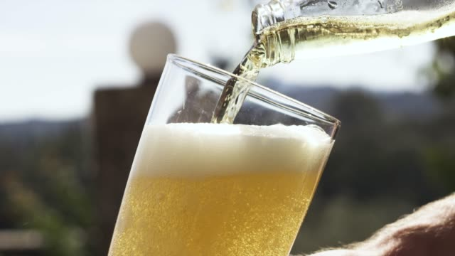 beer being poured into a glass - pouring stock videos & royalty-free footage